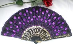 purple gold and black Spanish wedding fan.  You can also add flowers and ribbons.
