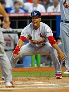 Beltran yells for his teammate to slide during the first game of the season.  4-4-12