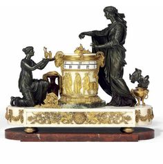 A LOUIS XVI ORMOLU MOUNTED WHITE, VERDE ANTICO AND ROUGE GRIOTTE MARBLE STRIKING MANTEL CLOCK OR 'PENDULE A CERCLES TOURNANTS  CIRCA 1785, THE CASE ATTRIBUTED TO PIERRE-PHILIPPE THOMIRE (1751-1843), THE DESIGN ATTRIBUTED TO JEAN-GUILLAUME MOITTE (1746-1810)