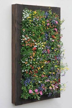 pallet garden To beautify your workplace or house, vertical gardening is filed with the most novel and outstandingly modern ideas. Those eye-catching, green living walls with colorful flowers impart stylish and mind-blowing chic to the place. Garden Wall Designs, Vertical Garden Design, Vertical Planting, Small Garden Wall Ideas, Verticle Garden, Vertical Pallet Garden, Vertical Wall Planters, Vertical Bar, Small Garden Design