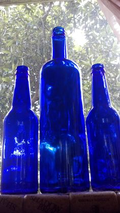 3 Cobalt Blue Glass Bottles/ man cave/ bar decor/ home decor stunning color. $9.99, via Etsy.