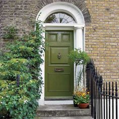 When siding presents an already complex field of color, best to pick up a hue thats already there. Loden Green - This color draws the eye to the door while its yellow under-tones echo the pale brick.  **Benjamin Moore's 'Great Barrington Green'
