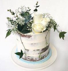 """HAPPY 60th x  8"""" round white chocolate mud cake filled with vanilla swiss buttercream. Topped with fresh flowers styled by me."""