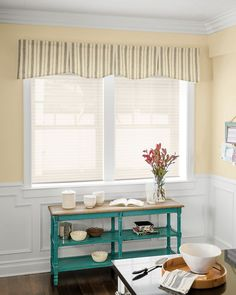 This traditional valance features gentle scallops punctuated by inverted pleats across the center portion of the treatment. Hudson Fabric Valance in Dexter Stripe/ Wheat.