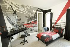 Designer: Kimberly Fox Designs, Morrow, OH A modern addition to this bedroom, this urban wall mural is striking, with coordinating home decor. This boy's bedroom reflects his interests and passions through the wall mural and other accessories in the room.