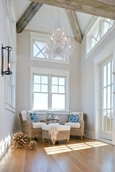 Small sitting room with tall ceiling featuring reclaimed beams, shiplap and a co… - Home Dekor Small Sitting Rooms, Coastal Chandelier, Twig Chandelier, Chandeliers, Beach House Decor, Home Decor, Beach Houses, Coastal Homes, Coastal Farmhouse