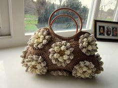 Super luxurious 3D floral crochet bag w/ free pattern.