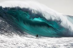 Australian surfer Marti Paradisis rides a wave near Pedra Branca Rock, south of Tasmania in the Southern Ocean. Photo by Andrew Chisholm (Reuters).