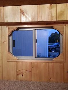 Great idea of a way to frame out those round corners on the horse trailer windows.  Could also make the trim extra wide and install mini blinds from top behind decorative trim.