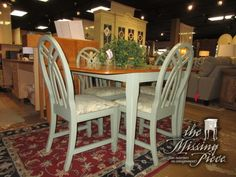 """Upscale country style dining table in a painted green finish with medium wood top and four chairs. The chairs have a pretty patterned seat cushion. Ideal for a kitchen or small dining area. 54""""L x 42""""W; (1)18""""leaf."""