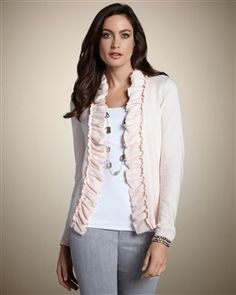Ritzy Ruffle Cardigan in a pale pink.