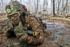 Crawling through mud, Pvt. Charles Shidler, Company A, Special Troops Battalion, 37th Infantry Brigade Combat Team, Ohio National Guard, searches for the next covered fighting position during individual movement techniques training at the Camp Ravenna Joint Maneuver Training Center, Ravenna, Ohio, April 17. Check out all of our military gear and supplies at http://www.chiefsupply.com/military-and-federal