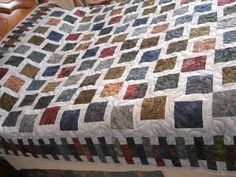 Customer's Batik Quilt: Stone Cottage, designed by Judy Martin. Pattern is in Judy Martin's Log Cabin Quilt Book. Great job!