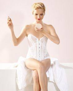 "For your big day, invest in lingerie as breathtakingly beautiful as it is functional, like this corset, which boasts intricate lace detailing as well as discreet boning that nips you in at the waist. Agent Provocateur ""Kate"" corset, agentprovocateur.com."