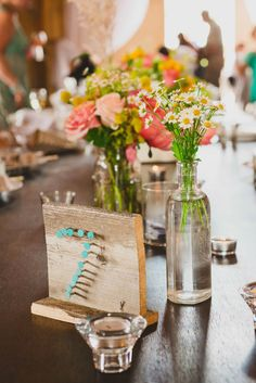 painted nails on wood table number // photo by June Cochran, flowers by Cori Cook Floral Design // View more: http://ruffledblog.com/colorado-country-wedding/