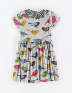 """""""A new style with gorgeous sequined logos teamed with our signature Boden prints. A woven skirt and thick sweatshirt top make this dress suitable to wear around town with boots, or along muddy paths in wellies."""" #MiniBoden #BacktoSchool"""