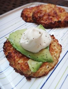 "Cauliflower Patties Cauliflower 'Bread' with Avocado ""- ultra low carb YUM! - I made this last week and am in LOVE. Even better baked the second time for leftovers!"" ""½ small cauliflower, trimmed of core one egg ¼ cup mozzarella cheese and Parmesan blend (you can just use mozzarella) 1 tsp dried oregano salt and pepper to season 1 tsp olive oil"""
