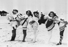 Bathing beauties in coy pose, at Coney Island, 1897.  (via:bygoneyears)