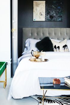 Tour a Lady's Stylish City Loft// murphy bed, tufted headboard