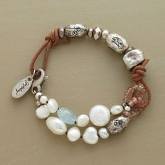 "OPEN COUNTRY BRACELET -- Pearls billow like clouds against the clear blue of aquamarine while handcrafted sterling beads line up like prairie hills. Strung on leather cord and handmade in USA by Jes MaHarry. 7-1/4""L."