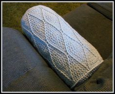 Harlequin Bolster Pillow  Designed by Julie A. Bolduc    This Pillow pattern was inspired by the Men's Ribbed Hat on this site. The ends are made similar to the first few rounds of the hat. Then the body of the pillow is made to resemble a Harlequin pattern design. It is fun to make and more for the intermediate to advanced crocheter.