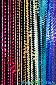 """This one has the pearlized finish that we call irridescent. It's also available in a non-irridescent finish.35"""" Wide x 70"""" Long: Our wonderful heavy-duty acrylic beaded curtains are a perfect additio"""