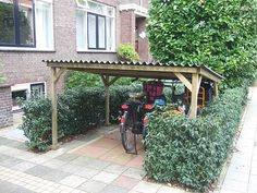 Want to find out about build your own shed plans? Then here is without doubt the right place! Garden Bike Storage, Outdoor Bike Storage, Bike Storage Rack, Garage Velo, Bicycle Garage, Bike Shed, Bike Storage Apartment, Outdoor Spaces, Outdoor Living