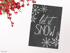 """Let it snow Christmas card in chalkboard style. Printable Christmas card or Christmas decor, available in instant download, featuring hand drawn snowflakes and the quote """"let it snow"""". This artwork has been hand lettered in distressed calligraphy by me, then scanned and digitally edited."""