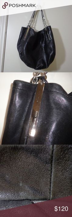 Michael Kors Black Leather Purse super soft, like butter, nearly excellent shape very small spot at bottom  metal magnet to close. inside has zippered pocket,  100 % authentic Michael Kors Bags