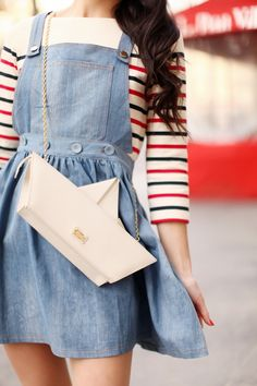 I love the striped shirt, the Jean skirt/overalls and that purse! So fun without…
