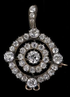 Fine Victorian diamond pendant, the pendant of open circular form with central old cut diamond estimated to weigh approximately 0.8 carats, surrounded by a border of twelve old cut diamonds within a concentric circle of sixteen further old cut diamonds interspaced by four larger old cut diamonds, set in a silver collet setting with gold galleried back with detachable diamond set bail and a brooch mount, in original fitted box.
