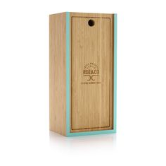 Crafted from bamboo, this hand-finished box boasts a strikingly raw and simple exterior, offset cleverly by the bold green border and etched Roe & Co logo. The front panel slides out smoothly to reveal the Roe & Co bottle, and has been cleverly designed to double as a cocktail preparation board. The natural antiseptic properties of the bamboo make it ideal for food preparation – whether you're slicing limes or piercing that perfect green olive. Luxury Packaging, Custom Packaging, Cocktail Garnish, Luxury Cosmetics, Packaging Manufacturers, Packaging Solutions, Limes, Food Preparation, Innovation Design