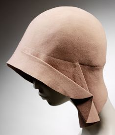 "1928/29 pink felt cloche hat. ""...worn with a Lanvin day-suit of pink marocain. The ensemble was worn by the donor for her second wedding in 1929. She recalled that this hat was a 'copy of a French model, purchased at the same time as the dress, and is characteristic of what was very smart indeed at that time'."""