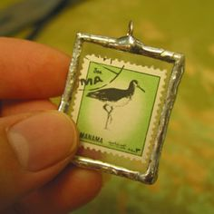 Postage Stamp Necklace - I'd like to try this with a photo of the kids.
