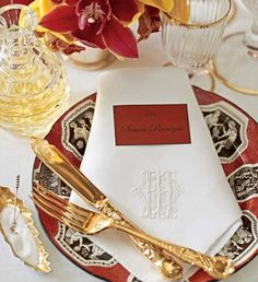 brick red & gold table setting . . .