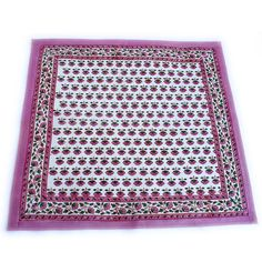 Wood- block printed napkins on 100% cotton. Small Indian flower motif in pink and green printed on white. Beautiful Borders. Sold in sets. Two for $15.00, Four for $28.00, or Six for $36.00.  Dimensions: - 18 wide x 18 long  Care Instructions: - Machine washable in cold water on a gentle cycle. - Use a mild detergent and never use bleach-based products. - Tumble dry on low heat or line dry. - Iron at medium heat, as necessary.  -Khush Rang textiles are wood-block printed by hand by local…