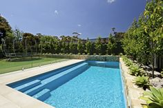 Gorgeous Swimming Pool Designs Pictures: Mesmerizing Swimming Pool Ideas Pictures Custom Designed Backyard With Private Pools In It Decorative And Relaxing Home Plunge Also Row Of Trees Completed With Another Plants Inspiration ~ dalatday.com Swimming Pool Inspiration