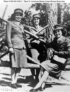Three Native American Marine Corps Women Reservists. The Native American Marine Corps Women Reservists are pictured at Camp Lejeune, North Carolina. The Women Marines are: (left to right). Minnie Spotted Wolf (Blackfoot Tribe), Celia Mix (Potawatomi Tribe), and Viola Eastman (Chippewa Tribe). Photographed 16 October 1943.