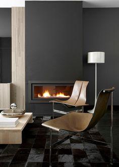 Dark walls + modern fireplace.