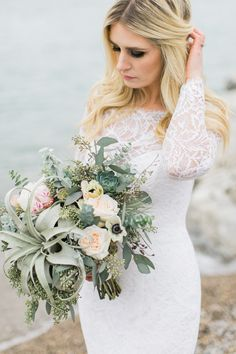 Bridal bouquet with succulents, air plants, eucalyptus and garden roses, Photography by @megann30