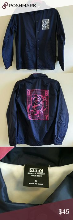 OBEY Clothing Rose Grid Coaches Jacket Obey windbreaker from 2016 summer collection. Water resistant. Navy Blue with white rose grid on the front and pink rose grid on the back. Worn once. In really good condition. Has drawstrings to adjust at the bottom. Obey Jackets & Coats