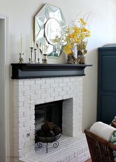 White brick / black mantel - love this.... I sometimes consider painting my exposed brick fireplace.