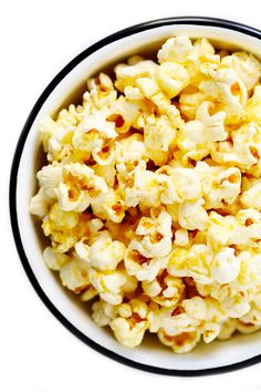 "The BEST popcorn recipe!! It super easy to make on the stovetop in 5 minutes with just ""nooch"" (nutritional yeast) instead of butter, coconut oil, popcorn and salt. Naturally vegan and gluten-free, and totally addictive! 