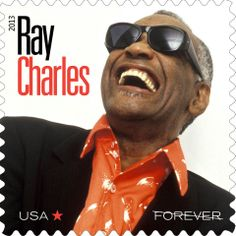 "The third stamp in the new Music Icons series will celebrate the life and music of Ray Charles. Blind from childhood, the extraordinary musician went beyond category, blending blues, gospel, country, jazz, and soul into a uniquely influential style. His hits include ""I've Got a Woman,"" ""Georgia on My Mind,"" and ""I Can't Stop Loving You."" (All rights to the name and likeness of Ray Charles are owned by The Ray Charles Foundation. Photo © MEPHISTO)"