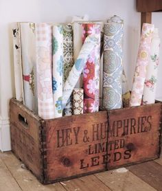 The Lovely Home of Lark wooden crate storage for rolls of wallpaper or gift wrap. already have some old wooden crates. Could def do this. Old Crates, Wooden Crates, Wooden Boxes, Craft Room Storage, Crate Storage, Storage Boxes, Fabric Storage, Craft Rooms, Storage Ideas