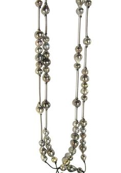 """Created by Robert Wan, this opera-length necklace contains a variety of different shaped Tahitian pearls randomly spaced along a 80"""" leather cord. There is a total of 78 pearls."""