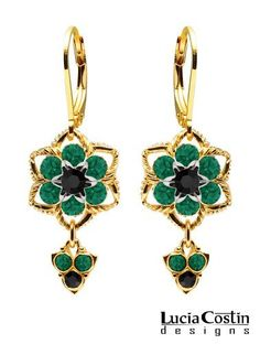 24K Yellow Gold over .925 Sterling Silver Flower Shaped Dangle Earrings by Lucia Costin Set with Black, Green Swarovski Crystals and Twisted Lines, Adorned with Cute Charms; Handmade in USA Lucia Costin. $59.00. Update your everyday style with inspiration when wearing this piece of jewelry. A perfect feminine touch. Adorned with black and emerald - green Swarovski crystals. Floral Earrings by Lucia Costin. Unique jewelry handmade in USA
