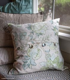 pillow with buttons and button loops
