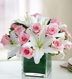Contemporary elegance meets classic style with this stunning bouquet. Gorgeous fresh pink roses share the stage with showy white lilies... #weddingflowers