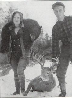 Mr. and Mrs. Harding, publishers of Fur, Fish and Game magazine, return from a successful outing in Northern Maine, 1935.